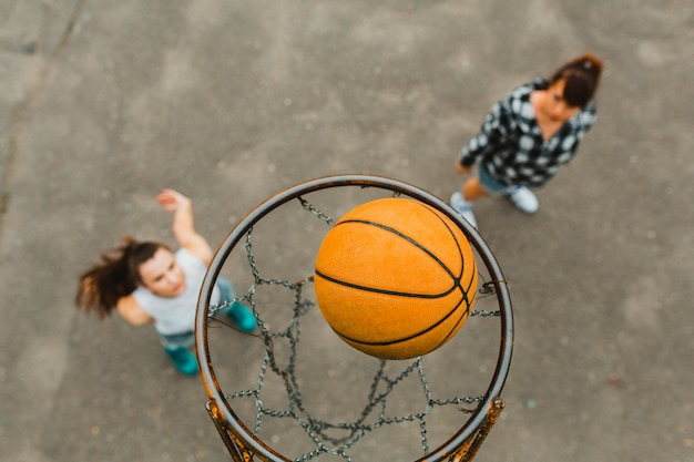 Top view with hoop of girls playing basketball 23 2147821057