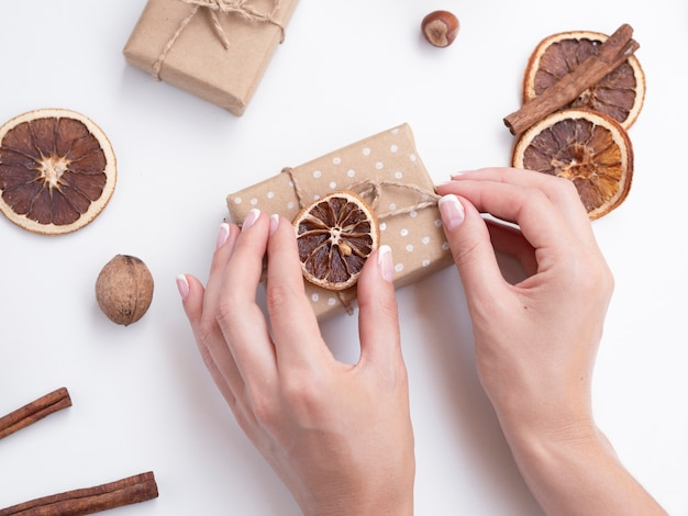 Top view of woman decorating gift boxes Free Photo