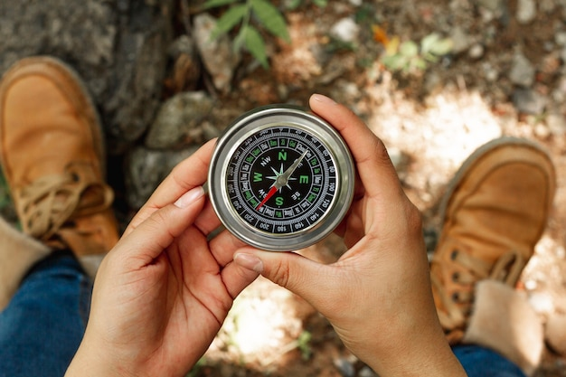 Top view woman holding compass Free Photo