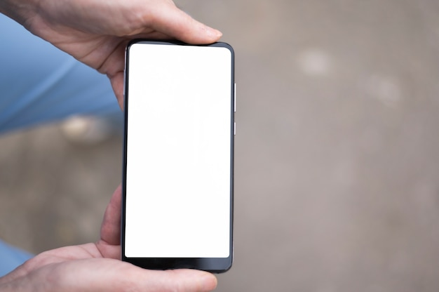 Top view of woman holding phone mock-up Free Photo