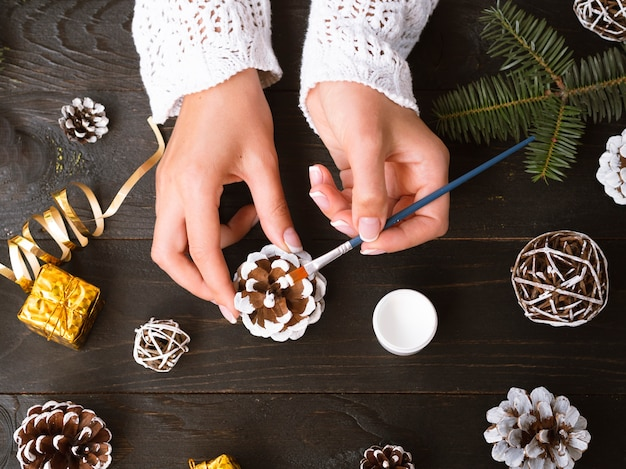 Top view of woman making christmas decorations Free Photo