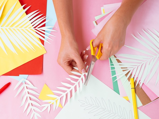 Top view of woman making paper decorations Free Photo