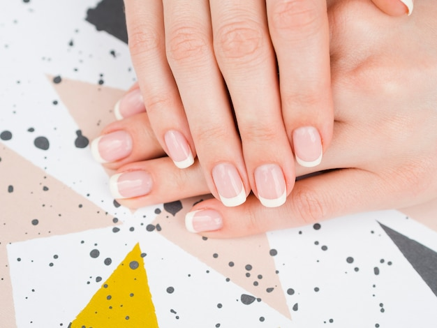 Top view woman's hands on geometric design Free Photo