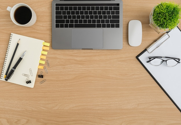 Top view wood office desk table. flat lay workspace Premium Photo