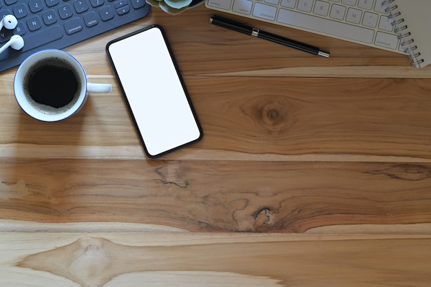 Top view wood workspace desk with copy space Premium Photo