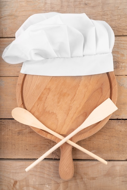 Top view of wooden spoons and chef's hat Free Photo
