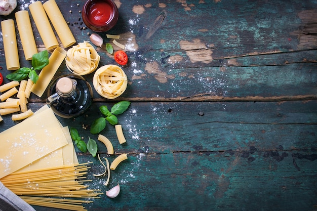 Top view of wooden table with different kind of pasta Free Photo