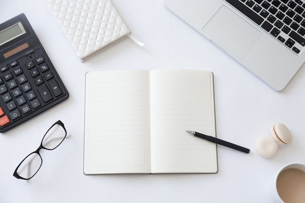 Top View Of A Working Desk With Open Notebook Photo Free Download