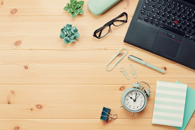 Top view over working place with laptop and office supplies Premium Photo