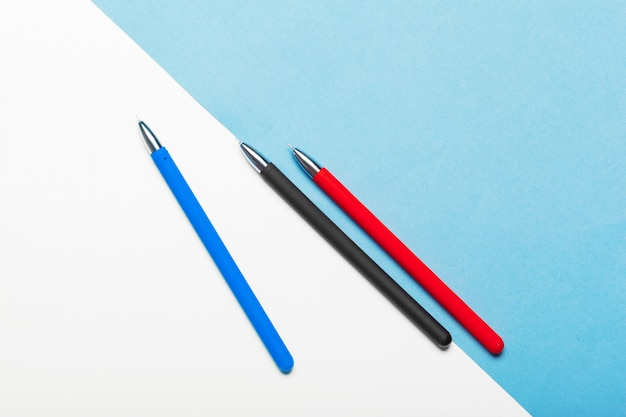 Top view workspace mockup on blue background with notebook Premium Photo