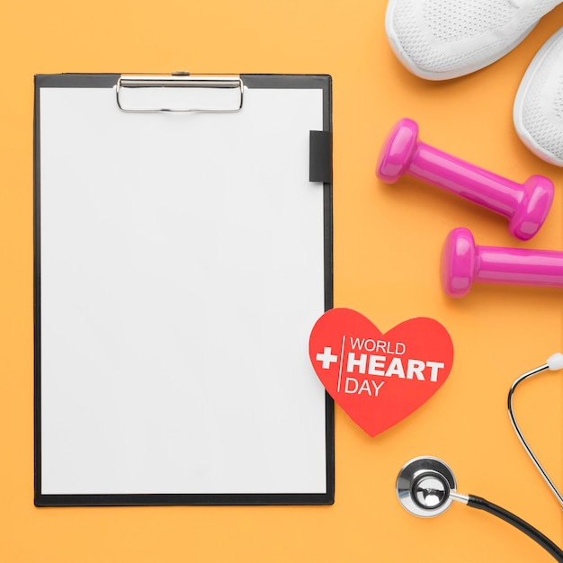 Top view world heart day concept with clipboard Free Photo