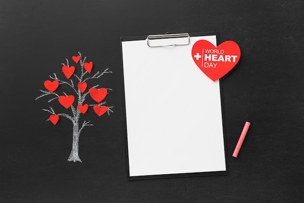 Top view world heart day concept with notepad Free Photo