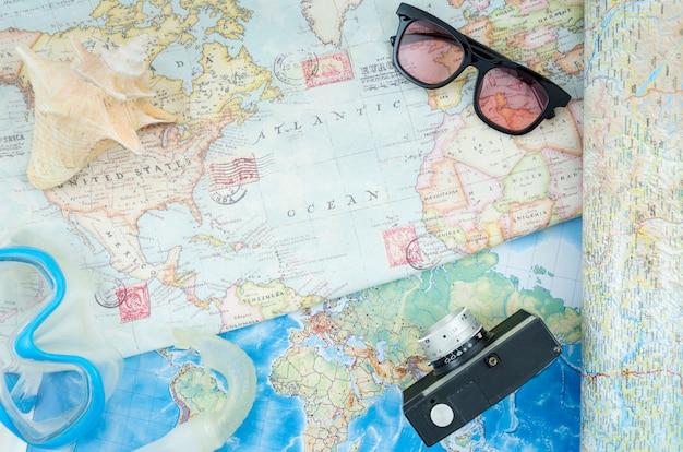 Top view world map and accessories Free Photo