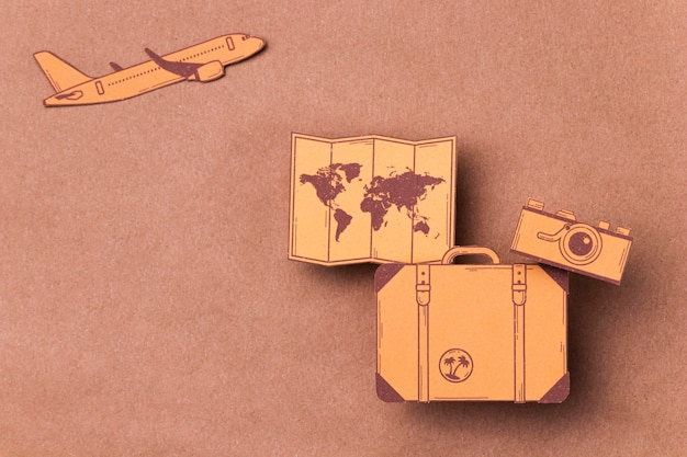 Top view world tourism day concept with luggage Premium Photo