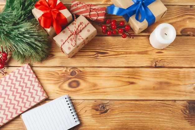 Top view of wrapped christmas gift boxes on wooden background Premium Photo