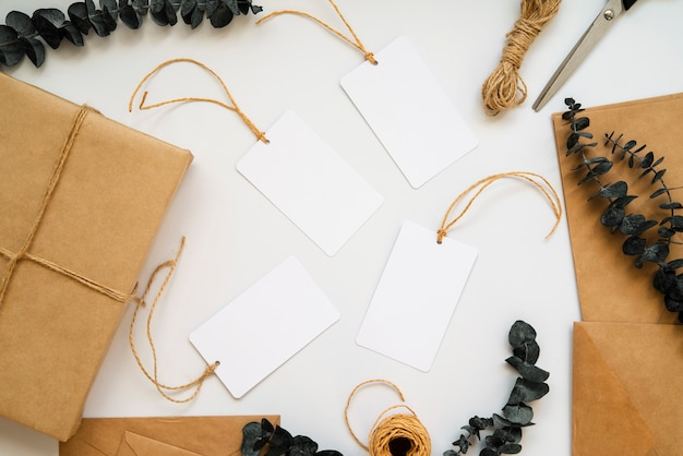 Top view wrapping paper and empty white labels Free Photo