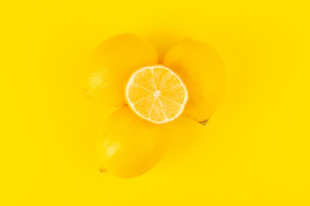 A top view yellow fresh lemons fresh ripe whole and sliced ...