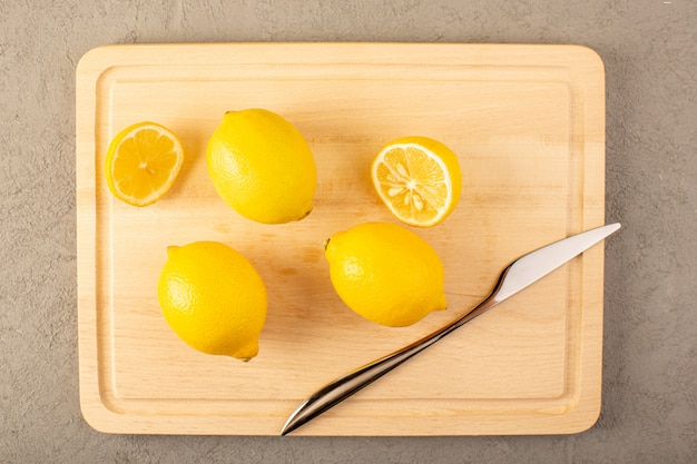 A top view yellow fresh lemons ripe mellow juicy surfaced ...