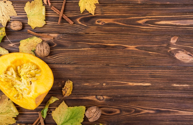Top view yellow pumpkin and walnuts with copy space Free Photo