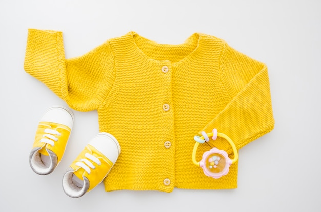 Top view yellow sweater with shoes Free Photo