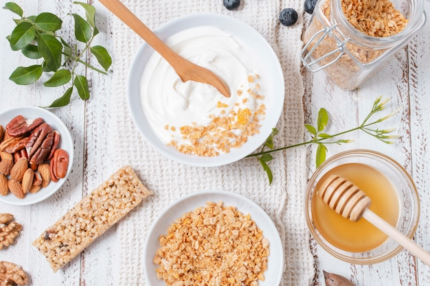Top view yogurt bowl with oats on the table
