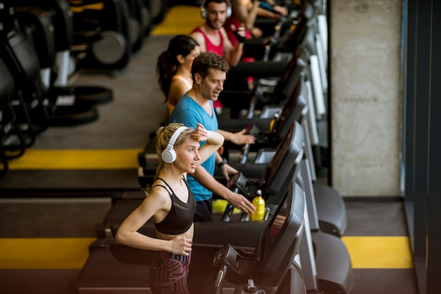 Top view at young people running on treadmills in modern gym Premium Photo