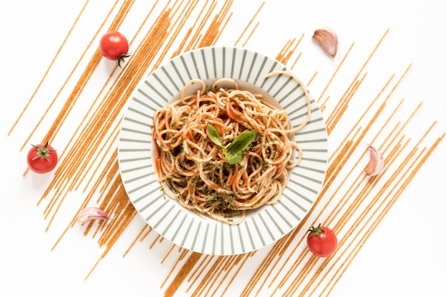 Top view of yummy spaghetti pasta and ingredient Free Photo
