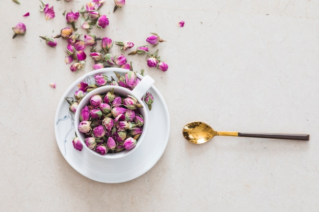 Top viewcup of tea full of flowers Free Photo