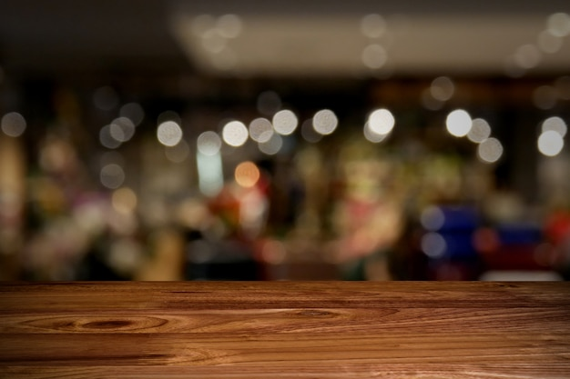 Top wood table with blur background Premium Photo