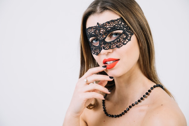 Topless woman wearing masquerade carnival mask and beads necklace Free Photo