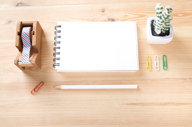 Topview of office stuff on wooden working table. Free Photo