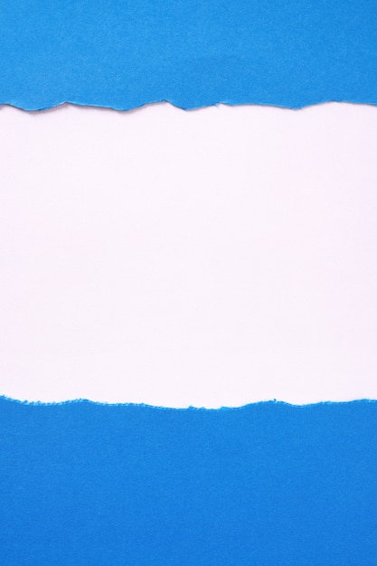 Torn blue paper white background border frame vertical Free Photo