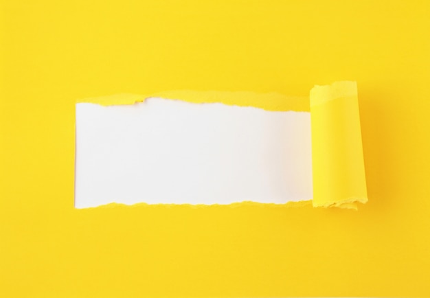 Torn colored paper, hole in the sheet of paper background Premium Photo