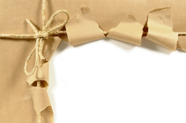 Torn open package with a bow Free Photo