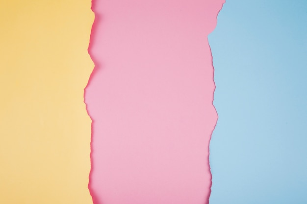 Torn paper pieces of soft colors Premium Photo