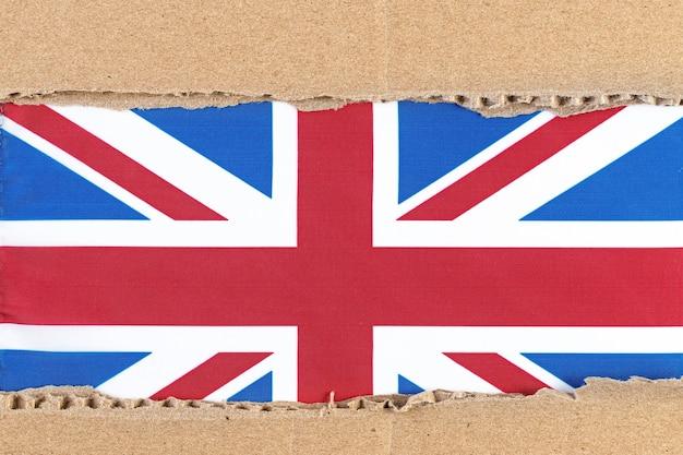 Рваная бумага с флагом соединенного королевства Premium Фотографии