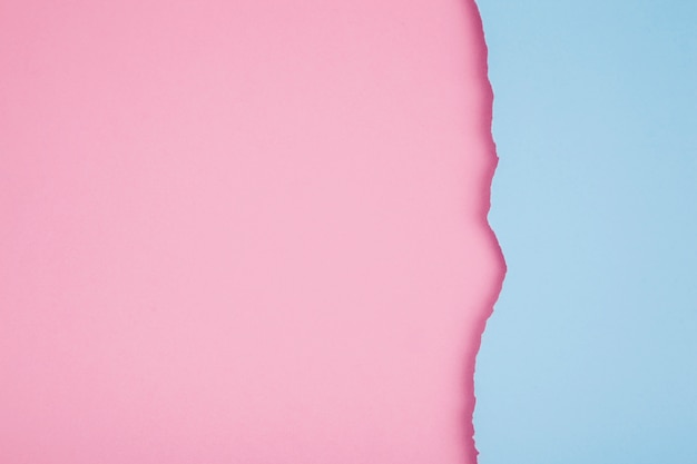 Torn papers of pastel colors Free Photo