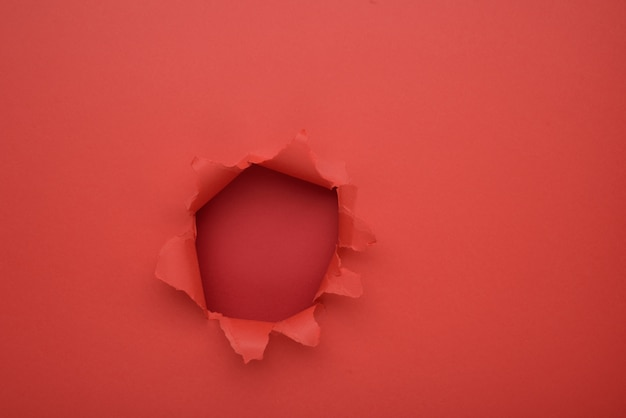 Torn red paper wall background. copy space aside for your advertising and offer or sale content. Premium Photo