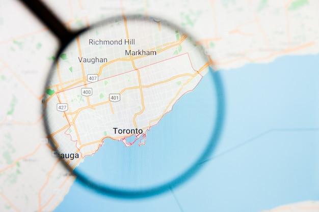 カナダのトロント市の拡大鏡による表示画面の視覚化の例示的な概念 Premium写真