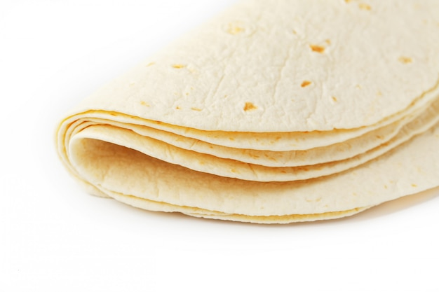 Tortilla . corn tortilla or simply tortilla is a type of thin unleavened bread made from hominy. Premium Photo