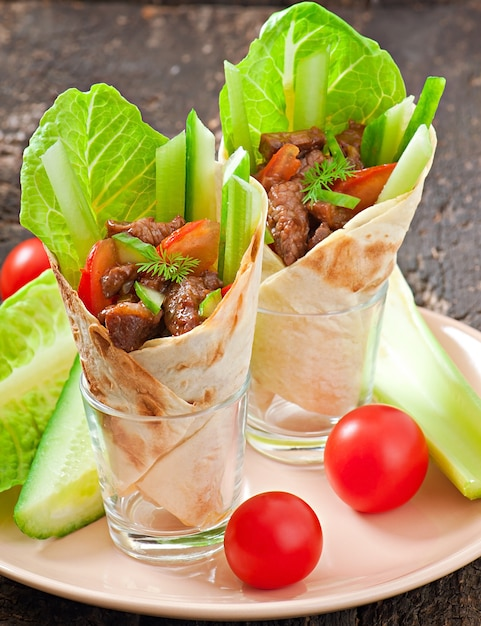 Tortilla wraps with meat and fresh vegetables Free Photo