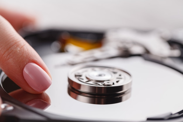 Touch of hdd surface by finger Premium Photo