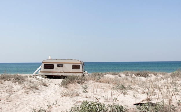 Tourism, leisure and travel. a tourist van and a sandy beach with a view of the black sea coast in the south of ukraine, kherson region. europe Premium Photo