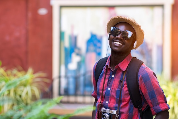 Tourist african man feel happy with travel place in scenery town. Premium Photo