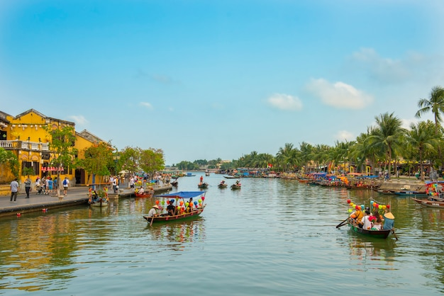 Tourist boat float at hoi an river in old town world heritage site in vietnam. Premium Photo