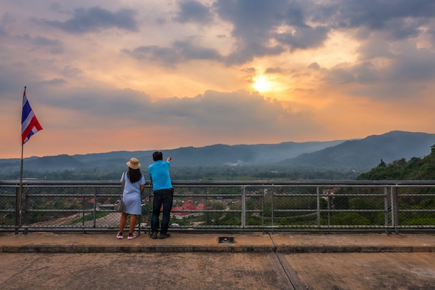Tourist couple of with great view at view of the river and mountains on khun dan prakan chon dam Premium Photo