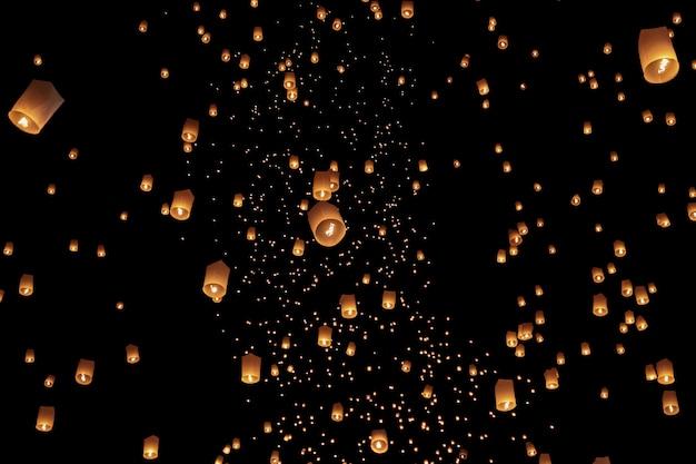 Tourist floating sky lanterns in loy krathong festival , chiang mai ,thailand Premium Photo