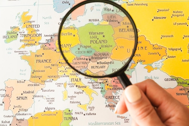 Premium Photo Tourist Holding Magnifying Glass On Poland
