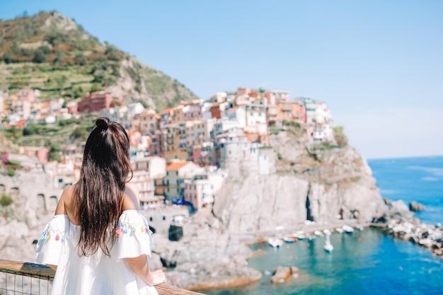 Tourist looking at scenic view of manarola, cinque terre, liguria, italy Premium Photo