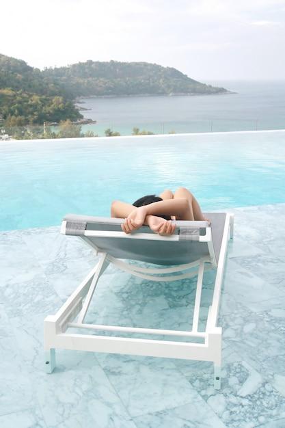 Free Swimming Pool: Tourist Sleep On Deckchair And Swimming Pool Photo